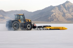 Colin Bond, at the wheel of the JCB heavy equipment, push-starts Dieselmax Andy Green on the Bonneville Salt Flats in 2006. Copyright 2006 Louise Ann Noeth